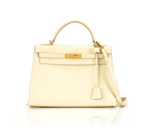 67080fedff0 Sotheby s  2 KELLY SELLIER 28 CALF BOX LEATHER CRAIE COLOUR WITH GOLD  HARDWARE. HERMÈS