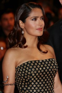 """CANNES, FRANCE - MAY 14:  Salma Hayek Pinault wears aPre SS13 Black & gold embroidered silk organza bustier gown and Diamond Bridge box clutch by Alexander McQueen and jewels by Boucheron attending the Premiere of """"Il Racconto Dei Racconti"""" (""""Tale Of Tales"""") during the 68th annual Cannes Film Festival on May 14, 2015 in Cannes, France.  (Photo by Danny Martindale/Getty Images for Kering)"""