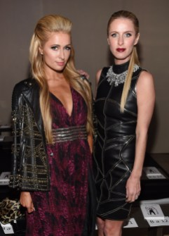 NEW YORK, NY - FEBRUARY 13: Paris Hilton and Nicky Hilton Rothschild attend the Front Row for the Philipp Plein Fall/Winter 2017/2018 Women's And Men's Fashion Show at The New York Public Library on February 13, 2017 in New York City. (Photo by Dimitrios Kambouris/Getty Images for Philipp Plein)