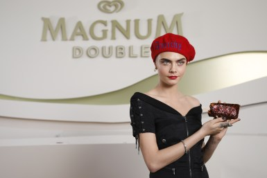 EDITORIAL USE ONLY Cara Delevingne makes her own personalised Magnum at the Magnum x Moschino launch event in Cannes, France. PRESS ASSOCIATION Photo. Picture date: Thursday May 18, 2017. Photo credit should read: David Parry/PA Wire