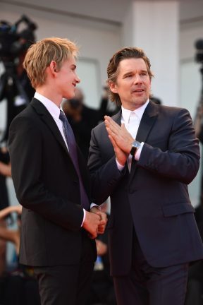 VENICE, ITALY - AUGUST 31: Actor Ethan Hawke wearing a Jaeger-LeCoultre Master Ultra Thin Moon watch with his son Levon Roan Thurman-Hawke (L) walks the red carpet during the 'First Reformed' premiere during the 74th Venice Film Festival at Sala Grande on August 31, 2017 in Venice, Italy. (Photo by Ian Gavan/Getty Images for Jaeger-LeCoultre) *** Local Caption *** Ethan Hawke; Levon Roan Thurman-Hawke