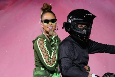 NEW YORK, NY - SEPTEMBER 10: Rihanna rides a dirtbike on the runway at the FENTY PUMA by Rihanna Spring/Summer 2018 Collection at Park Avenue Armory on September 10, 2017 in New York City. (Photo by JP Yim/Getty Images for FENTY PUMA By Rihanna)