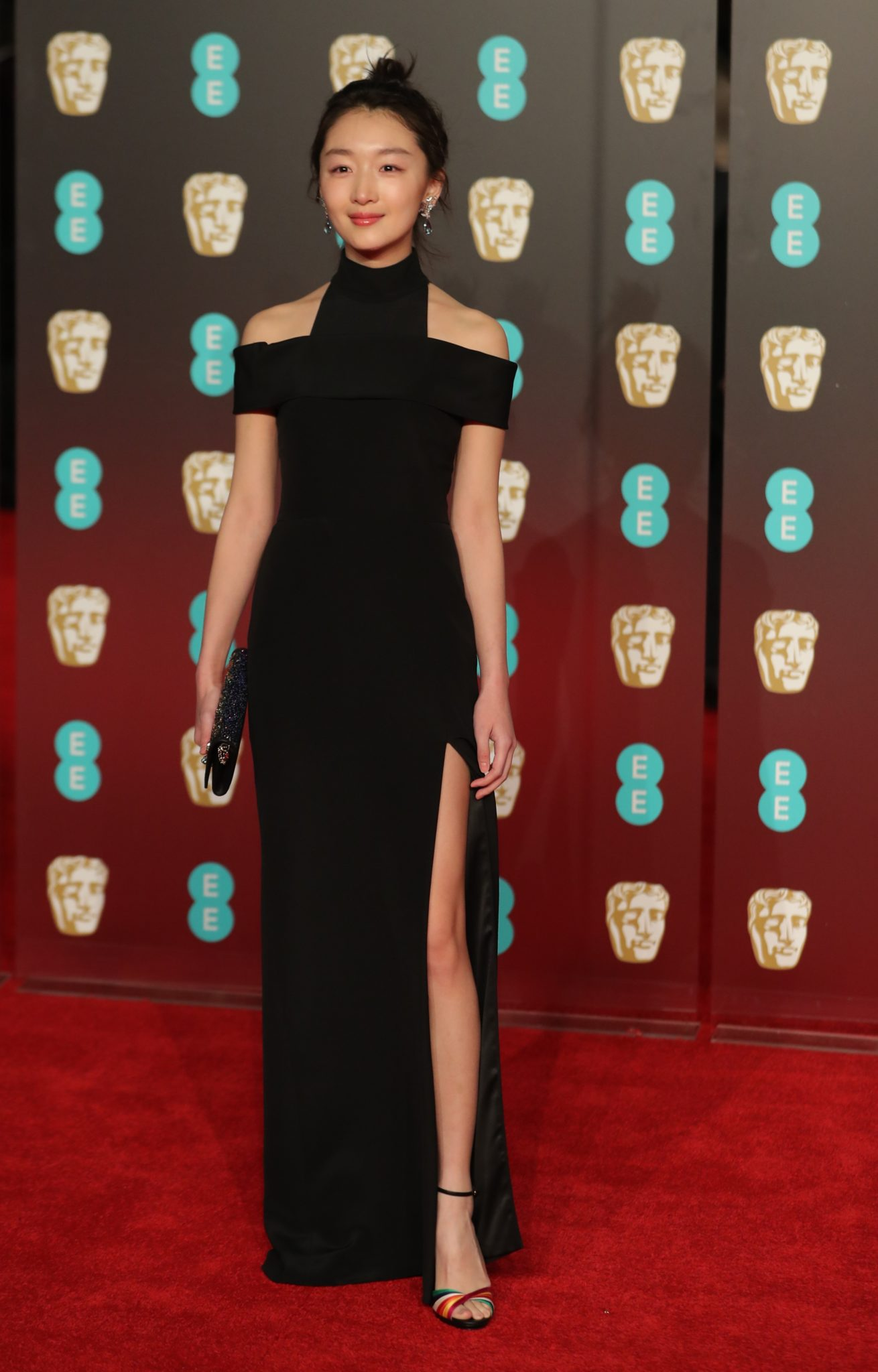Chinese actress Zhou Dongyu poses on the red carpet upon arrival at the BAFTA British Academy Film Awards at the Royal Albert Hall in London on February 18, 2018. / AFP PHOTO / Daniel LEAL-OLIVAS (Photo credit should read DANIEL LEAL-OLIVAS/AFP/Getty Images)