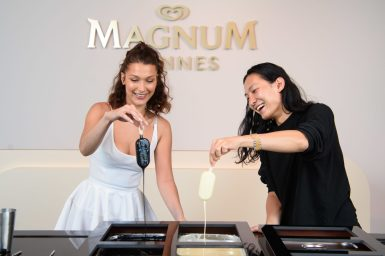 EDITORIAL USE ONLY Bella Hadid and Alexander Wang make their very own personalised Magnums at the Magnum x Alexander Wang event in Cannes. PRESS ASSOCIATION Photo. Picture date: Thursday May 10, 2018. Photo credit should read: Matt Crossick/PA/Magnum