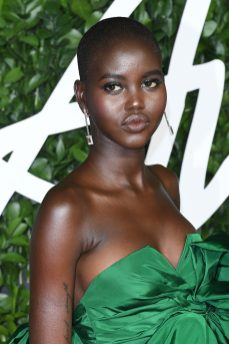 LONDON, ENGLAND - DECEMBER 02: Adut Akech arrives at The Fashion Awards 2019 held at Royal Albert Hall on December 02, 2019 in London, England. (Photo by Daniele Venturelli/Daniele Venturelli/WireImage )