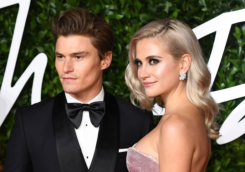 LONDON, ENGLAND - DECEMBER 02: Pixie Lott (R) and Oliver Cheshire arrive at The Fashion Awards 2019 held at Royal Albert Hall on December 02, 2019 in London, England. (Photo by Jeff Spicer/BFC/Getty Images)