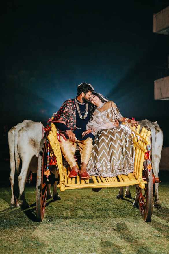 loving ethnic couple in traditional outfits