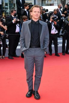ALEX LUTZ IS DRESSED BY DIOR HE WORE A GREY MOHAIR WOOL TUXEDO WITH BLACK SATIN LAPEL, A CLASSIC BLACK COTTON SHIRTS A BLACK SILK BOW-TIE AND A PAIR OF BLACK LEATHER DERBIES