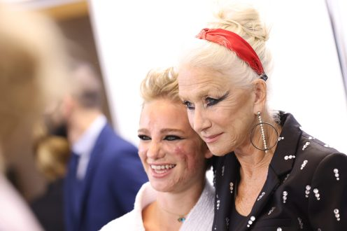 """PARIS, FRANCE - OCTOBER 03: Beatrice Vio (L) and Helen Mirren prepare backstage prior to 'Le Defile L'Oreal Paris 2021"""" as part of Paris Fashion Week on October 03, 2021 in Paris, France. (Photo by Vittorio Zunino Celotto/Getty Images For L'Oreal)"""