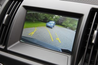 Another new feature for Land Rover Freelander 2 is rear view camera capability. The view from the back of the vehicle is displayed on the Infotainment screen with dynamic lines representing the boundaries of the vehicle and your predicted path as you reverse. The system also incorporates 'Hitch Assist', a graphic superimposed on the camera showing the position of the tow ball.