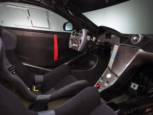 Inside the cockpit, the 12C Can-Am Edition is race ready as well. Two black race seats, complete with full six-point harnesses are mounted within the cabin, while a full race-specification rollcage has also been fitted. The steering wheel is carried over from the 12C GT3, with the shape and grip derived from that of Lewis Hamilton's MP4-24 Formula 1 car, while carbon fibre detailing also continues throughout the cabin, across the dashboard and sill panels. An integrated air conditioning system, mandatory now in a growing number of race series, is also present.