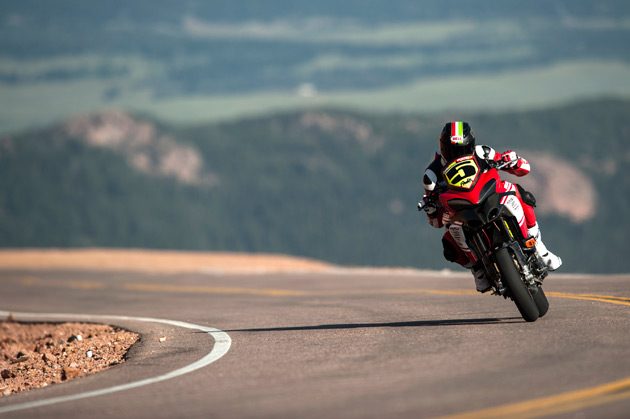"Carlin Dunne dominated the 2012 Pikes Peak International Hill Climb, setting the new course record for motorcycles today from pole position for the second year in a row on a Ducati Multistrada 1200 S. This win marks Ducati's third-straight victory at the historic ""Race to the Clouds"". Photo credit: Jamey Price"