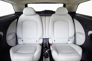 The car's interior has been designed specifically for this model. Its highlight is the innovative rear seat, which has been styled around a lounge concept. Two individual chairs provide generous levels of head, shoulder and knee room with outstanding comfort and support. Armrests have been integrated into the rear trim. A two-section version of the MINI Centre Rail storage and attachment system – first seen in the Countryman – comes as standard. A full-length variant is available as an option.