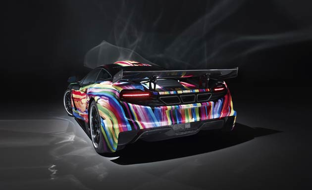 """During the complex modification process, the engineers paid special attention to ensuring the car's light weight. To achieve this, Hamann has made ample use of the extremely light – yet ultra-strong – material of carbon, which, because of its positive properties, can be found in abundance in the standard model. To perfect the car's overall appearance, Hamann has fitted """"unique forged formula"""" rims."""
