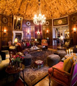 Each remarkable lodge features an eclectic mishmash of interior furnishings and fittings with African styles and European influences: graceful antiques, African treasures neatly placed, beaded chandeliers hanging above large gilt mirrors and billowing raw silk curtains that brush the tops of beautiful Persian carpets.