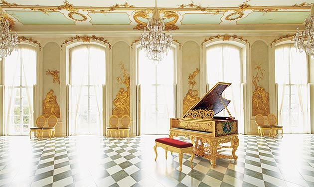 With masterful craftsmanship and advanced technology, the company's piano-makers have re-created the precious golden rococo grand piano once built for the court of Queen Victoria.