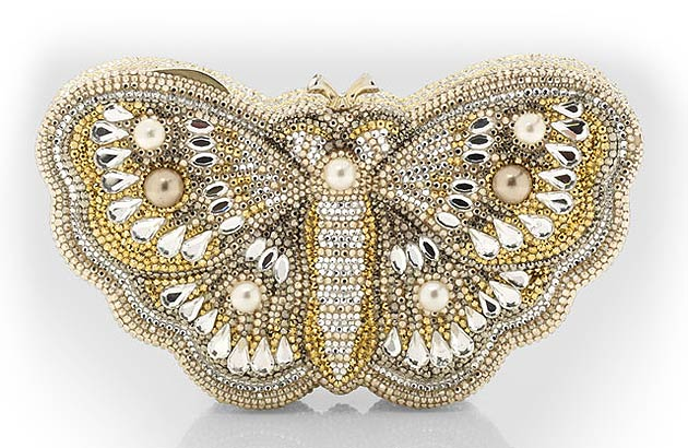 To some ladies who lunch and dames who dine, no evening gown will be complete unless you are carrying a Judith Leiber bejewelled minaudière to a black tie event or a charity ball. A work of art or a whimsical sparkling accessory?