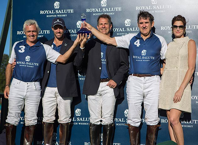 The Royal Salute team holding the winning Trophy at the Royal Salute Jubilee Cup held at Greenwich, CT, USA.