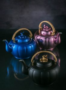 In celebration of the 10th anniversary of the establishment of Royal Selangor's first Visitor Centre, a limited edition range featuring replicas of the Melon Teapot are given three coloured finishes to represent Kuala Lumpur, Penang and Singapore; three cities where Royal Selangor Visitor Centres can be found