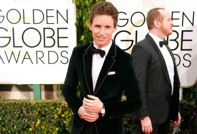 Eddie Redmayne wearing a Chopard Classic Manufacture watch in rose gold at the 72nd Golden Globes