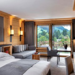 Dark Brown Leather Chair Hanging Black Park Gstaad Hotel - 'the Last Paradise In A Crazy World'