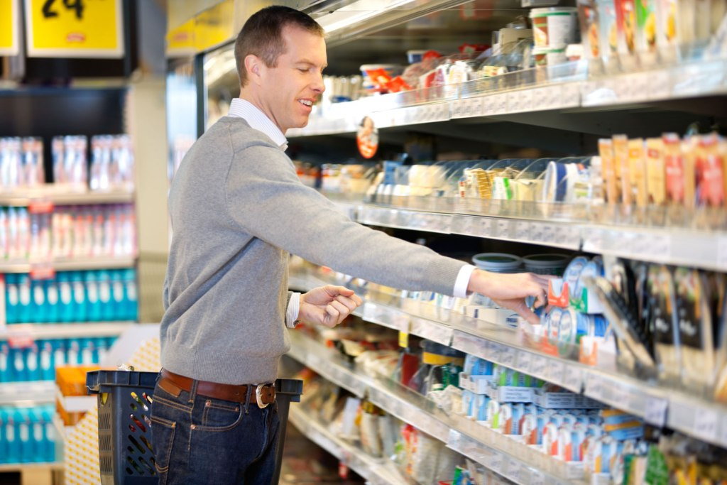 Man shopping in a UK supermarket