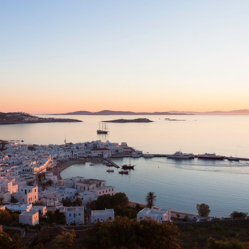 Town and harbour of Chora at sunset. Mykonos, Cyclades, Greece.