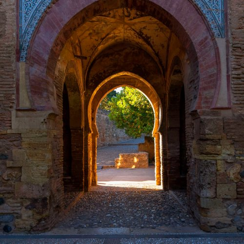 Moorish arched doorway in Alhambra, a palace and fortress complex located in Granada, Andalusia, Spain.