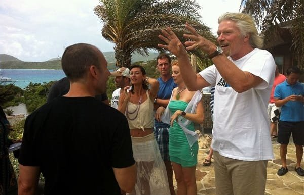 Richard Branson talking to Joe Player and guests on Necker Island