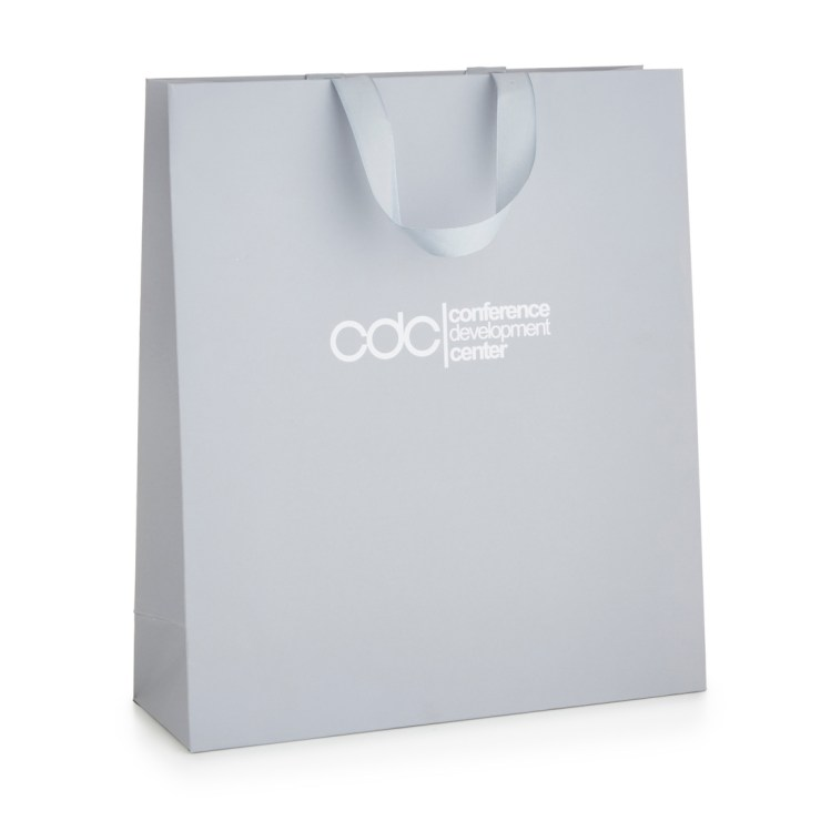Unlaminated Paper Bag with inserted ribbon handle. Made from uncoated art paper.