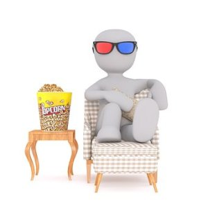 a white feature wearing a 3d glass sitting on a chair with popcorn beside it