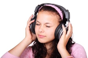 a girl listens to a headset