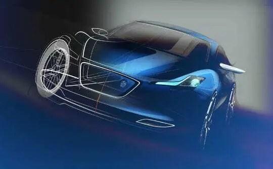 Modelo de carro feito a partir de software catia v5. Carro azul com pedaços mostrando linhas criadas dentro do software.