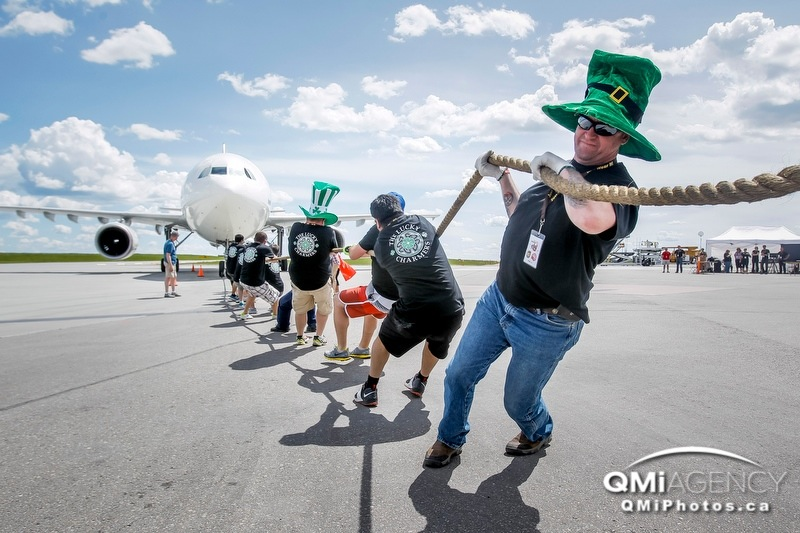 Terry Kuiper leads a pull with CanElson Drilling's team, the Lucky Charmers, during Pulling for U at the UPS airport headquarters in Calgary, Alta., on Sunday, June 22, 2014. The Lucky Charmers finished third, as teams competed to pull a 200,000-pound Airbus A300 plane 50 feet, all in support of United Way. Lyle Aspinall/Calgary Sun/QMI Agency