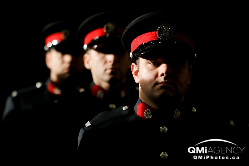 Newly minted constables stand during the Calgary Police Service's graduation ceremony for class 203 at Mewata Armoury in Calgary, Alta., on Friday December 13, 2013. Lyle Aspinall/Calgary Sun/QMI Agency