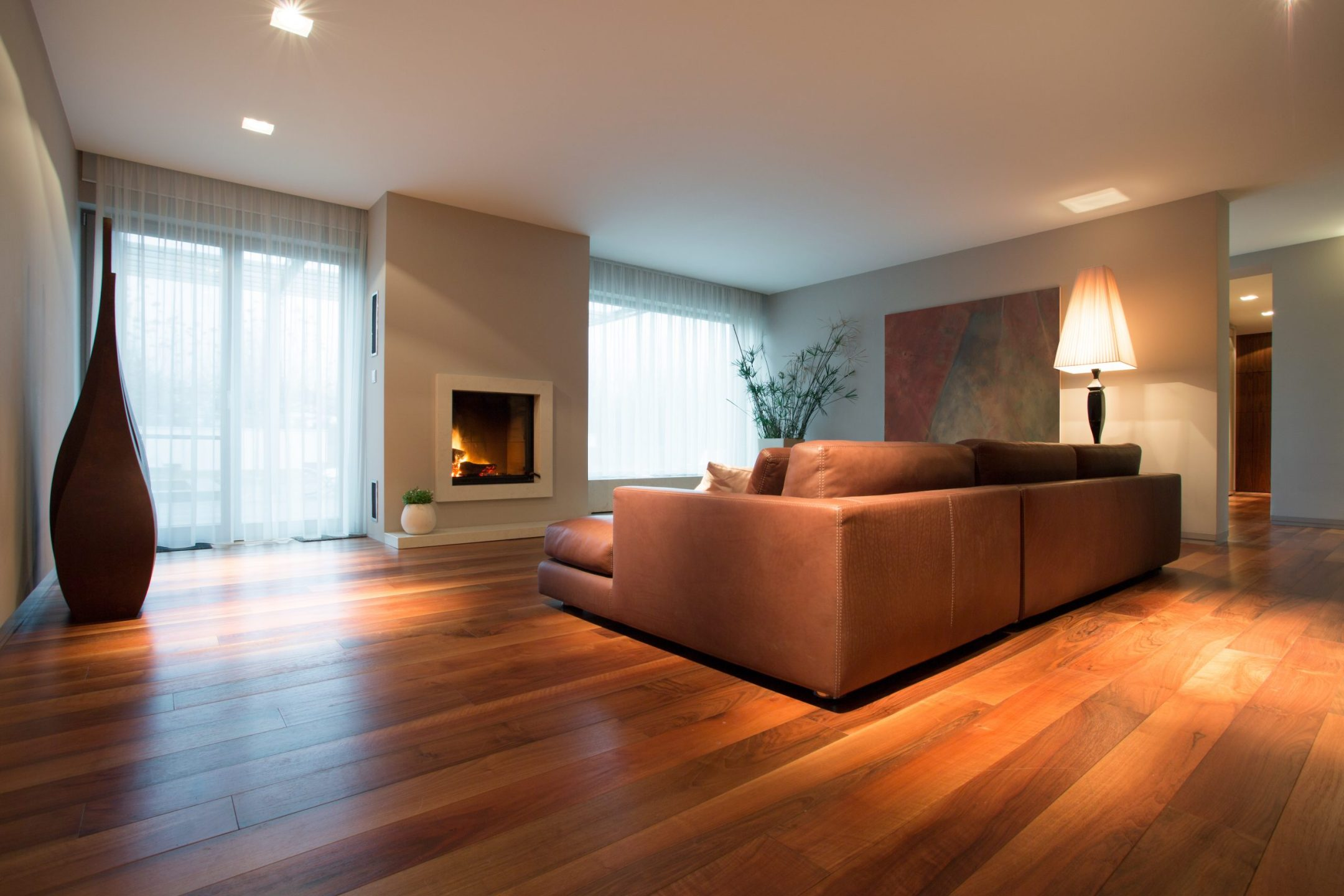 A living room with natural wood floor