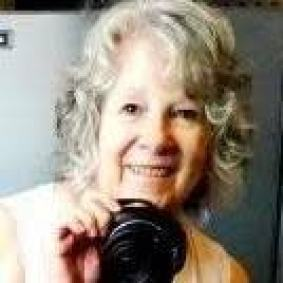 Photo of Lynda with camera.