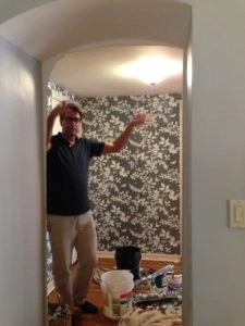 Gerard transforming our entry with his excellent wallpaper skills