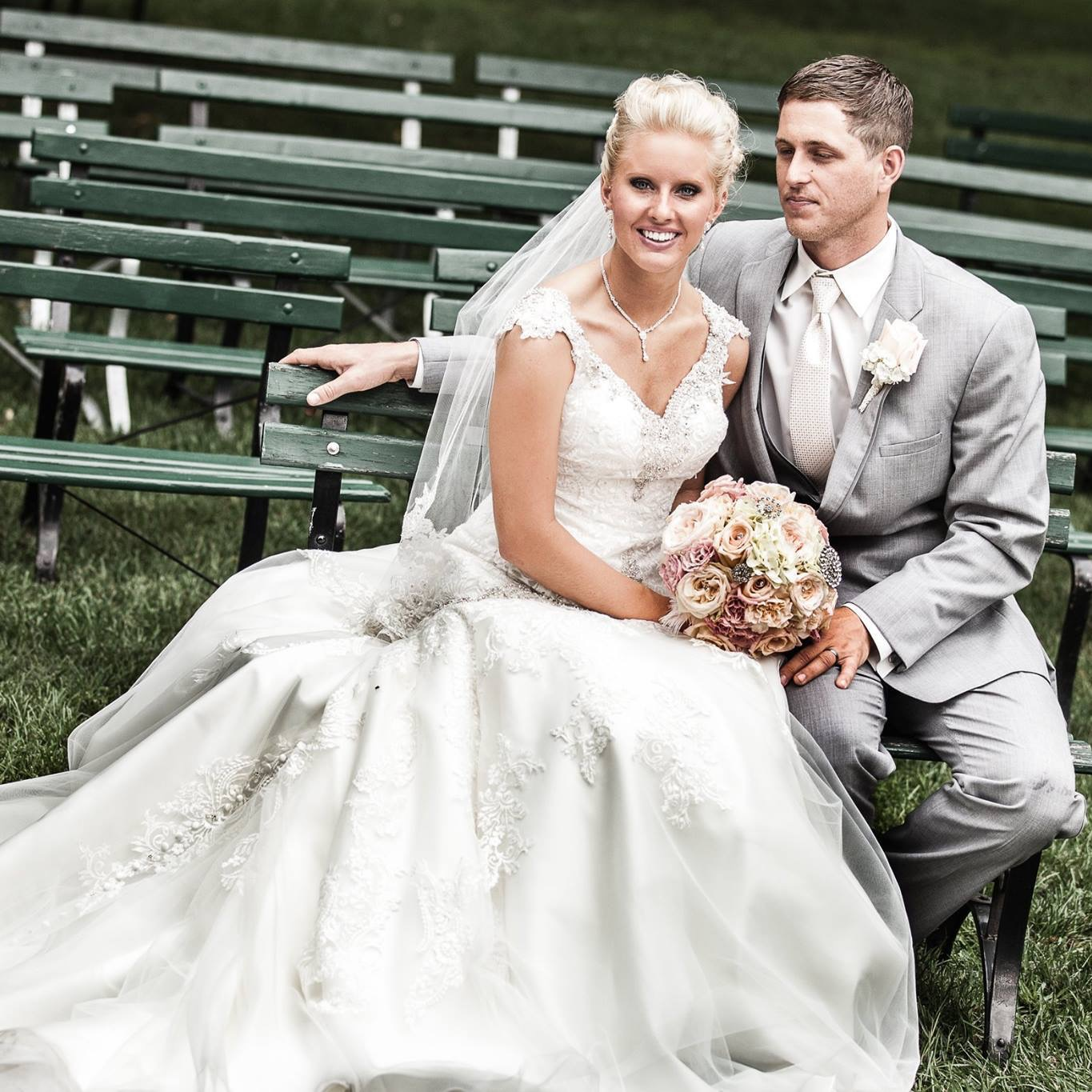 bride-and-groom-with-flowers-on-bench