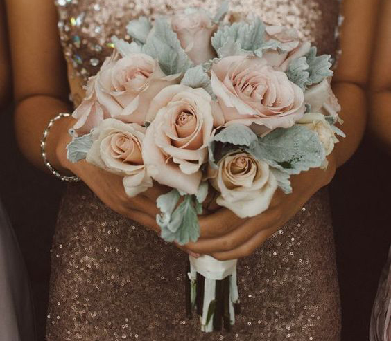 hands-holding-prom-flowers