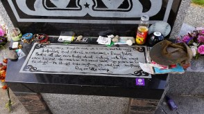 Fans leave items at the memorial