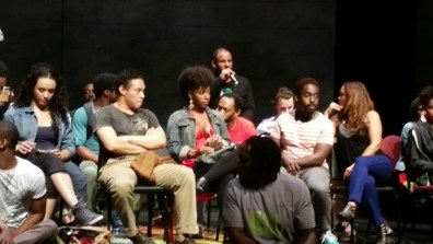 actors sitting on stage