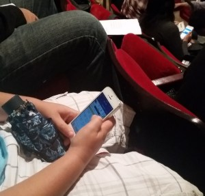 child looking at raven score on phone