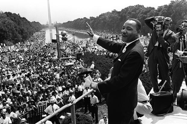 Civil rights leader Martin Luther King waves to a crowd estimated at 250,000 during his speech on the Mall in Washington DC during the ''March on Washington'' on Aug. 28, 1963. As he spoke, King envisioned a future of racial equality with his ''I Have a Dream'' speech. (AFP)