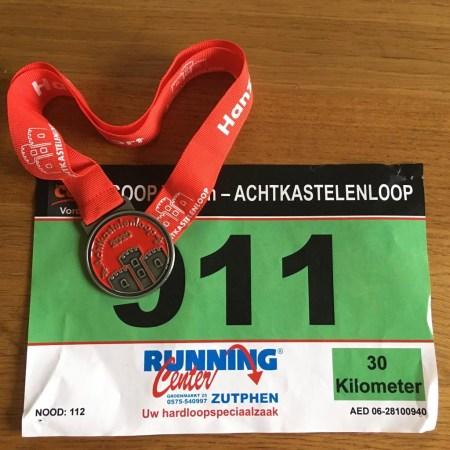 Start nummer en medaille Achtkastelenloop