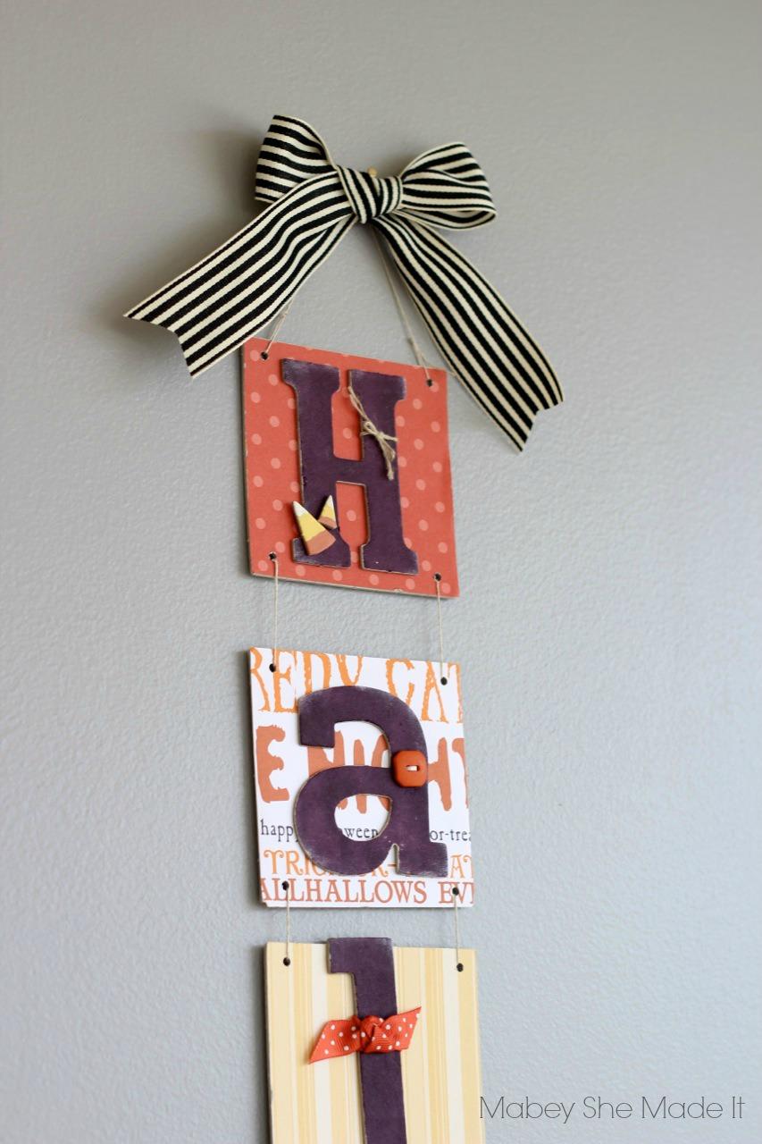 Halloween Door Hanging   Mabey She Made It   #halloween #halloweendecor #candycorn #papercrafts @mabeyshemadeit