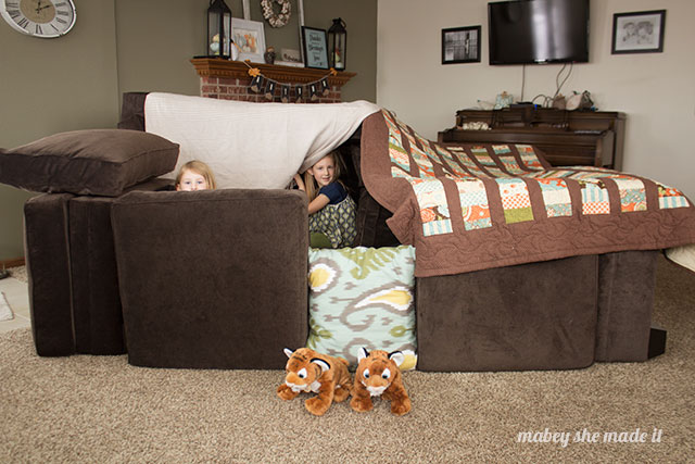 Building a fun sofa fort on a snowy day.