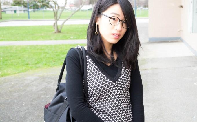 wearing a black v neck sweater-7