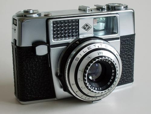 This, I am fairly sure, is similar to the camera I bought in 1963. It is the Silette-LK and came with a variety of optional lens and shutter configurations. Note the light meter window, top left. Photograph from Camerapedia.com from Süleymandemir