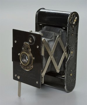 An example of an early Kodak Vest Pocket camera. Compact kit in its day, using 127 film (Image Wikipedia Commons).